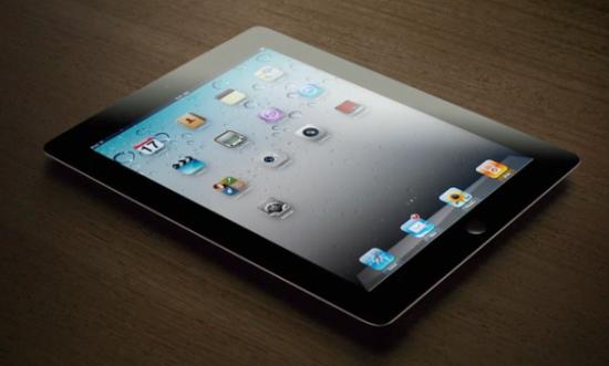 ipad 2 advert now ipad 2 flat on wooden tablet