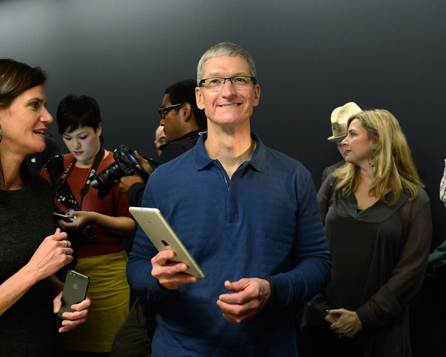 Tim Cook holds iPad with Katie Cotton Jacqui Cheng