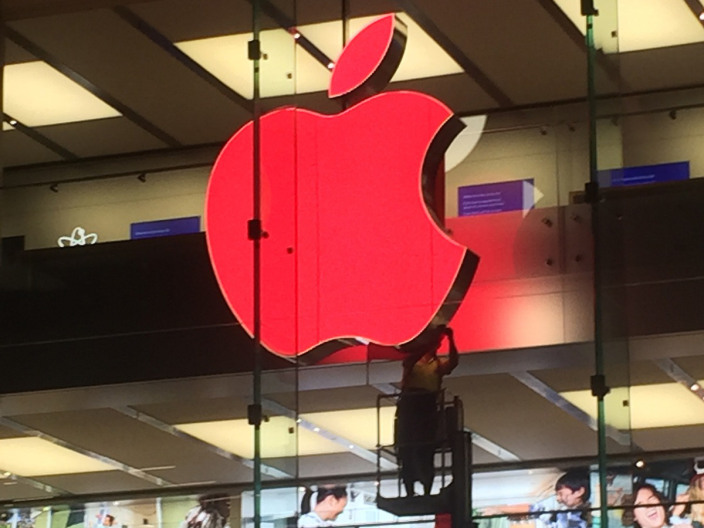 red apple logo retail store